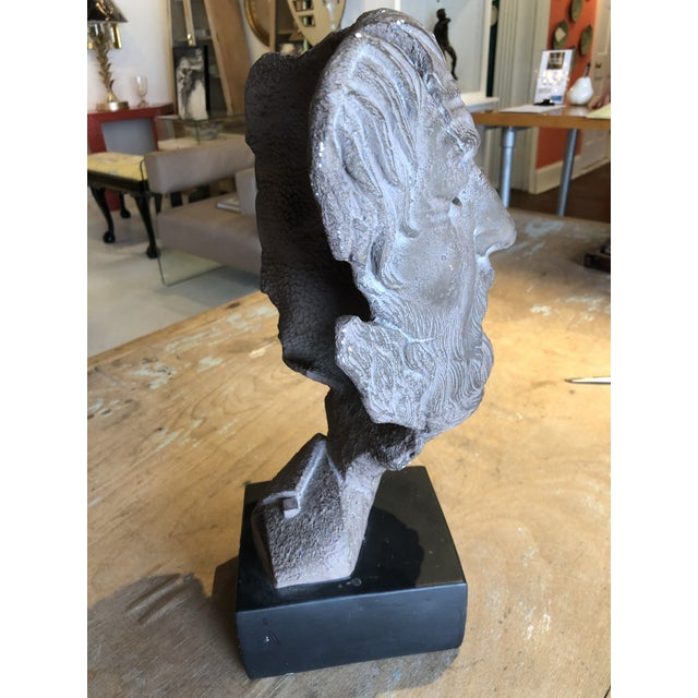 Hellenic style plaster bust of a man on a plaster stand. This interesting bust has great facial detail and interesting...