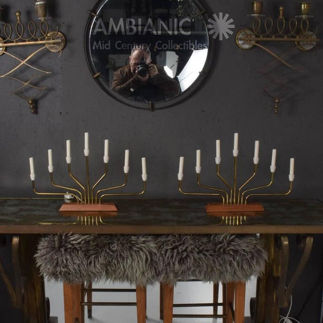 For your consideration a vintage pair Danish modern table lamps with seven arms in the shape of the menorah. Teak base...
