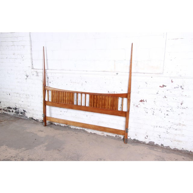 A gorgeous mid-century modern sculpted cherry wood king size headboard by John Widdicomb. The headboard features gorgeous...