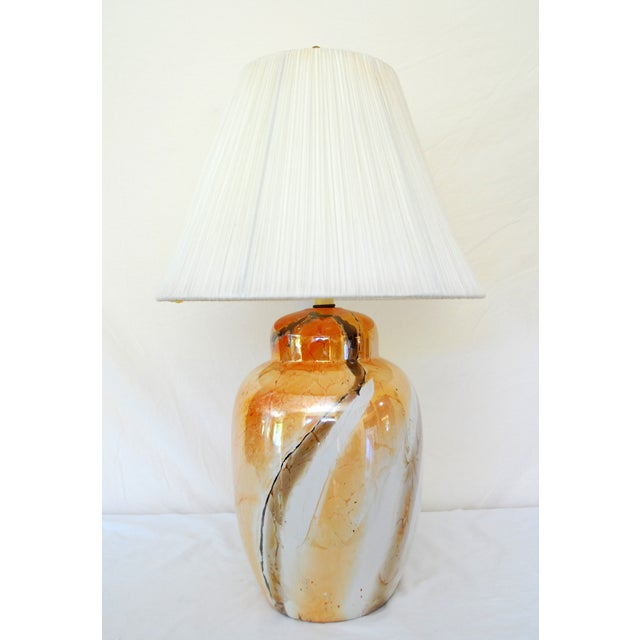 Vintage marbled ginger jar-style lamp and shade. Main color is burnt sienna and burnt umber. The lamp has a glossy finish...