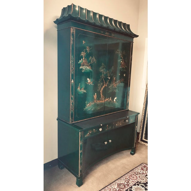 Magnificent emerald green lacquer Chinoiserie secretary two part desk features a pagoda top and gold figural scenes on an...
