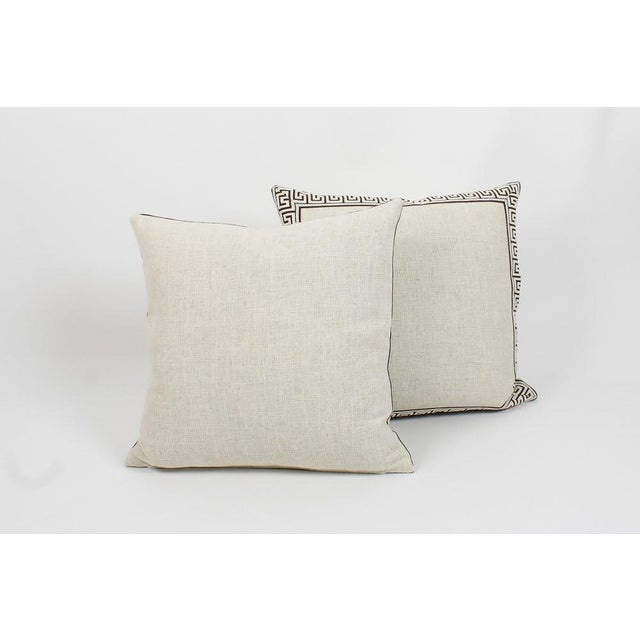 Pair of custom oatmeal color linen pillows with coordinating chocolate-and-ivory colored Greek key tape on fronts. Solid...