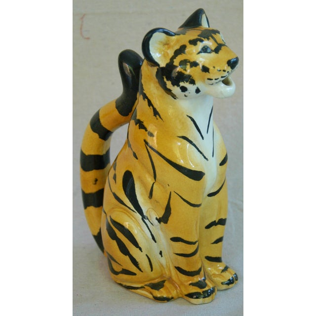 "Italian hand-painted ceramic tiger water pitcher. Marked ""R.E.M.O. Made In Italy 1975."" Excellent condition."