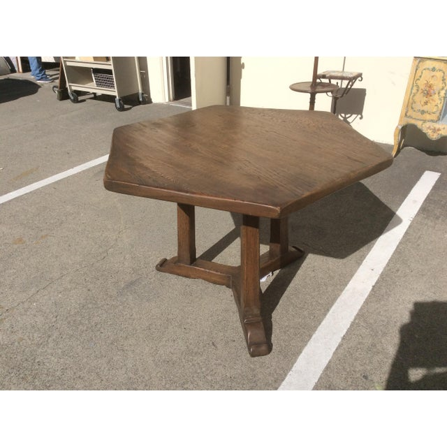 Nice looking thick oak rustic style English made center table with three legged base and six sided top.