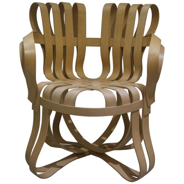 This pair of bentwood chairs were designed by Frank Gehry for the Knoll furniture company and date to 1993. They are known...