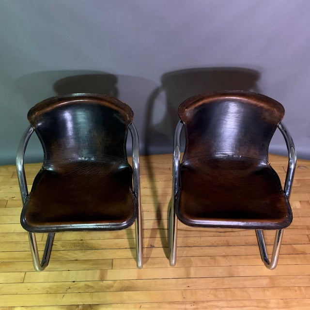 Classic set of four Willy Rizzo dining chairs in dark brown stitched saddle leather over chromed continuous tubular steel...
