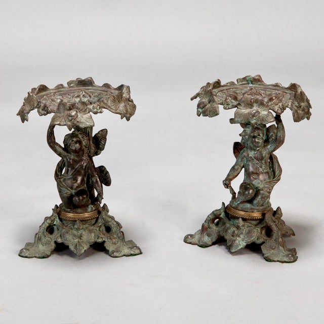 Pair 19th century tall bronze tazzas with Figural Putti and Ivy. Beautifully sculpted cherubs / putti with a base and...