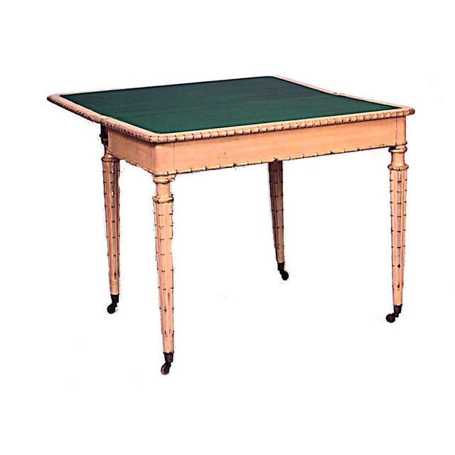 English Regency style (19th century) painted faux bamboo four legged flip-top console table with red leather top.