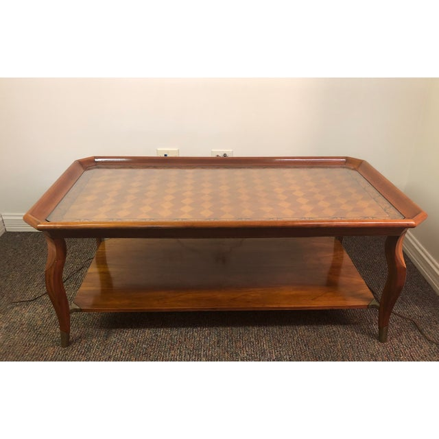 John Widdicomb Furniture 2 tier coffee table. Various wood types of inlay. Harlequin pattern. Brass brackets and leg caps....