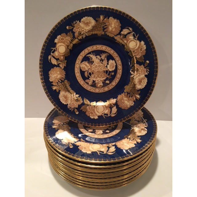 Decadent cobalt blue and gold Spode service plates in pristine condition. Fruit and flowers in an urn, circa 1920 - 40....