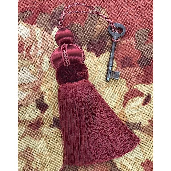 """Red key tassel with hand cut velvet ruche, decorative gimp and twisted cord detail. Total height including cord - 10""""..."""