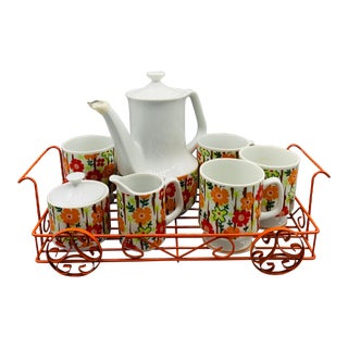 1960's Vintage Ceramic Floral Coffee Pot Set of Eight Includes Cups, Creamer, Sugar Bowl and Carrying Basket For Sale