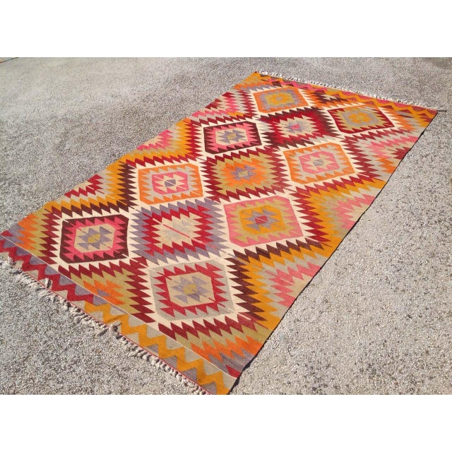 This gorgeous, vintage, handwoven kilim is approximately 60 years old. It is handmade of wool in all natural colors. It...
