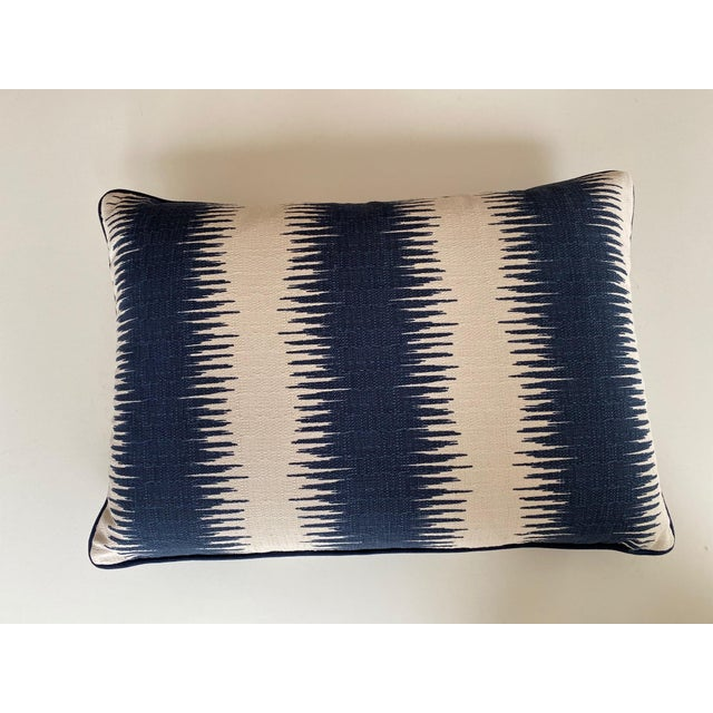 A pair of navy and cream striped ikat rectangular pillows. The tailored pillows are the perfect size for club chairs, a...