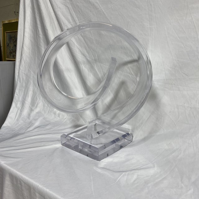 Very cool thick lucite curled ribbon sculpture on pivoting base.Beautiful condition. Near perfect. No signature. Lucite...