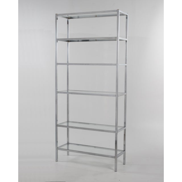 Mid-Century Modern chrome étagère with six glass shelves on a square chrome frame. Great display and storage!