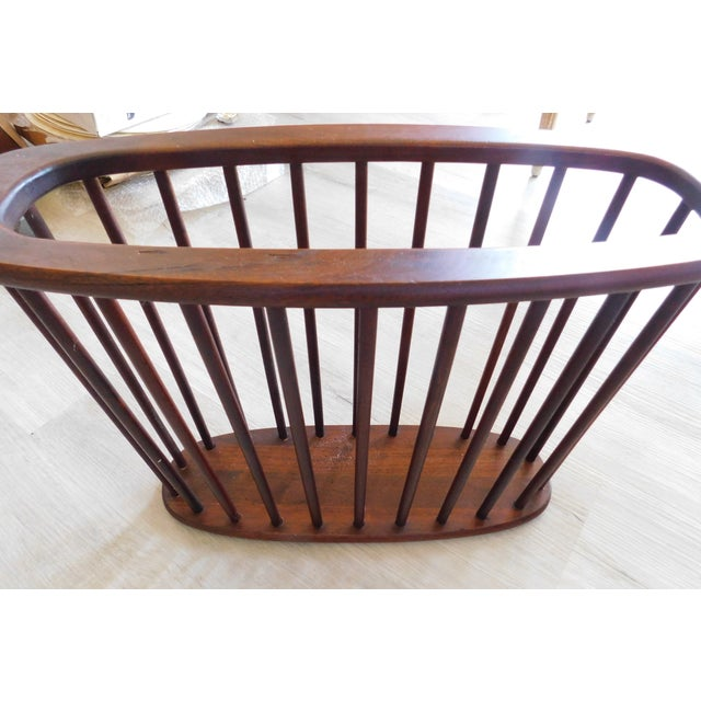 Fabulous Mid-Century Modern Walnut Magazine Rack with tapered spindles measuring 14.50 inches tall x 21.0 inches wide x...