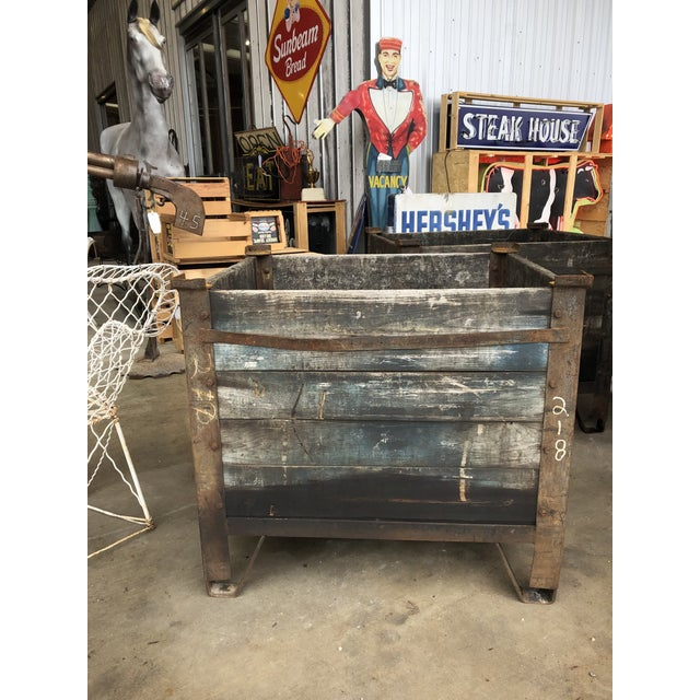 1900's American industrial planter. Made of metal and steel.