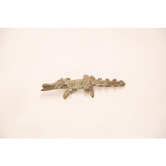 Vintage handmade bronze African sculpture of a crocodile with an oxidized patina. Circa mid 20th century and possibly...