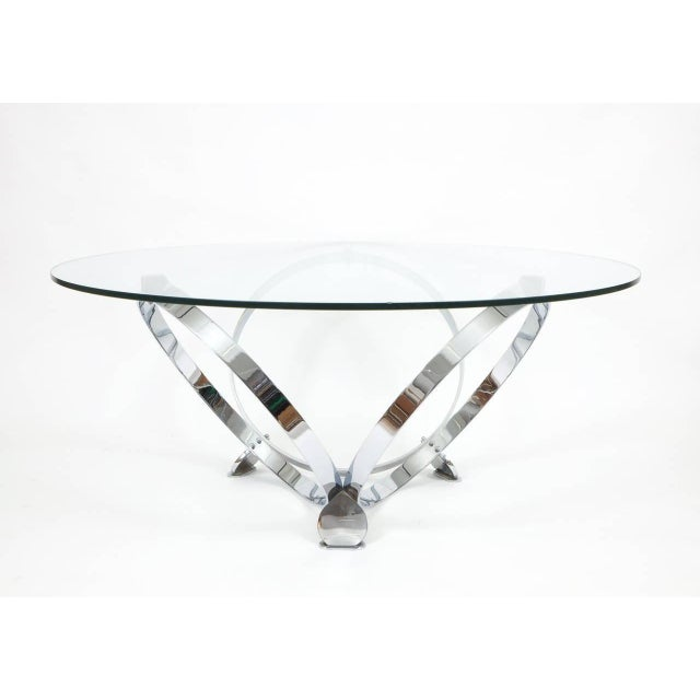 Stylish chrome ring table made from solid chromed metal rings and a floating glass top. Please note that the table will be...