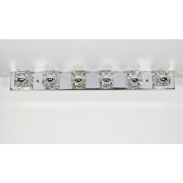 Mid-Century Modern sconce featuring six hand-cut glass block shades. Streamline frame in polished chrome with cubist...