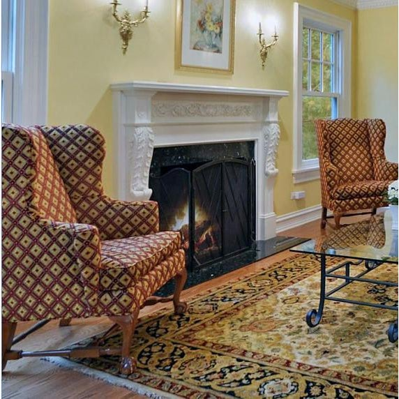 A wonderful pair of Baker wingback chairs in luxury upholstery. Chairs sit on ball-in-claw feet. Minor wear throughout...