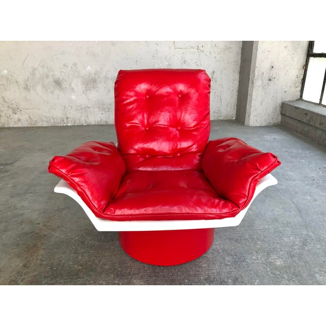 This is an incredible space age molded plastic and red leather lounge chair by Futorian. Dating back to the late 60s or...