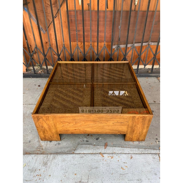 Beautiful Drexel Heritage coffee table with wicker top and smokey glass top, can be used indoors and outdoor decor.