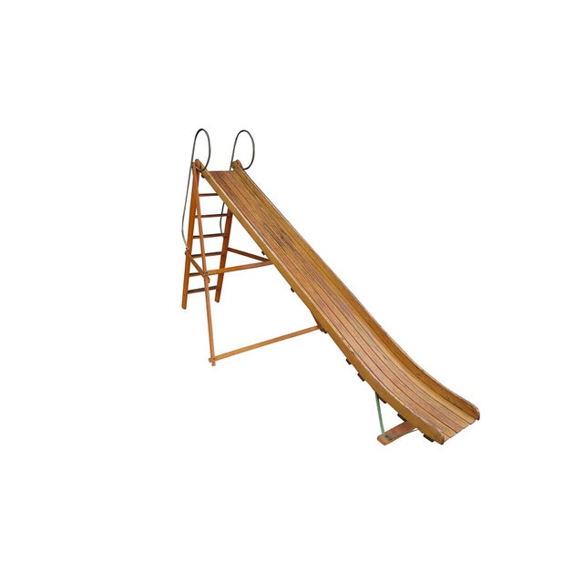 Vintage bent wood playground slide. Original finishes with even age appropriate patina. Was installed at one property...