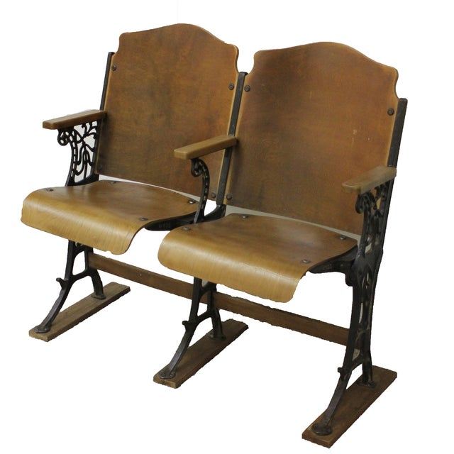 A pair of early, 1900s, antique, wood theater seats with cast iron base - Antique Wood And Cast Iron Theater Seats - Pair Chairish