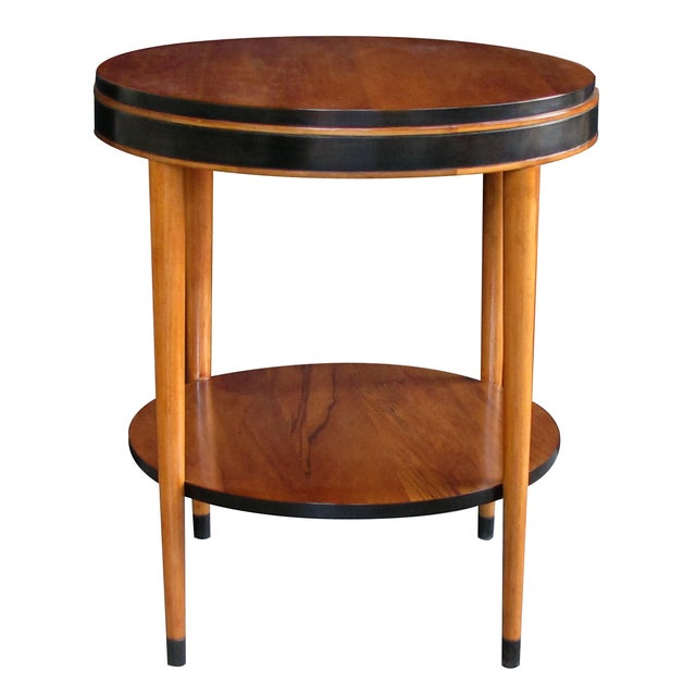 chic and tailored in style, this circular table with stepped apron raised on tapering turned supports connected by a lower...