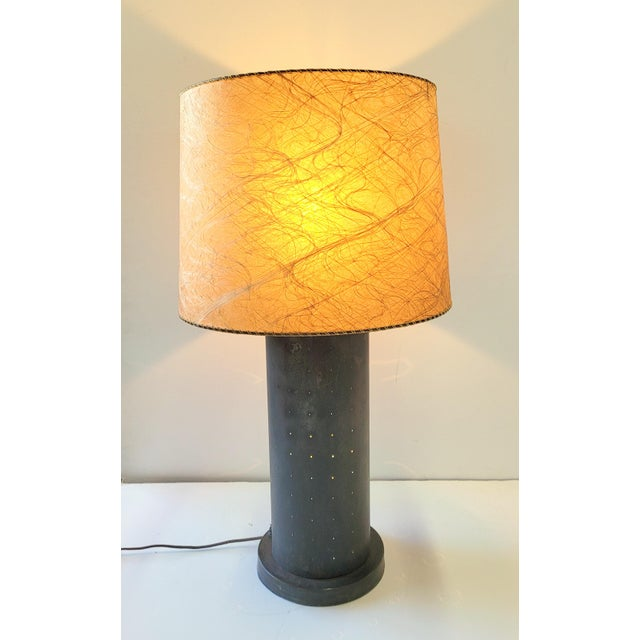 Midcentury table lamp with pinhole lights in base. Finish is a distressed dark bronze on metal. Switching allows for the...