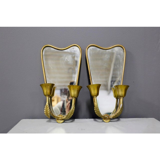 Pair of small Italian wall lights from 1950. The wall lamps, as can be seen from the photographs, serve as a double...