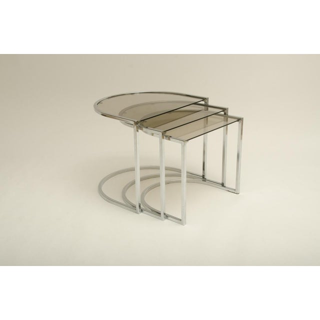 Attractive set of three Mid-Century glass and chrome nesting tables by Milo Baughman. The tables are in excellent condition
