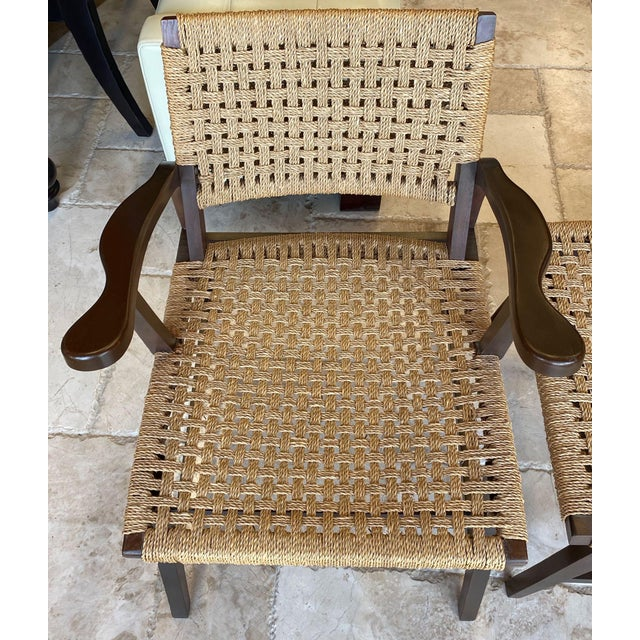 Pair of small lounge chairs in the manner of Hans Wegner. These Mid-Century/ Danish Modern chairs have low seats and...