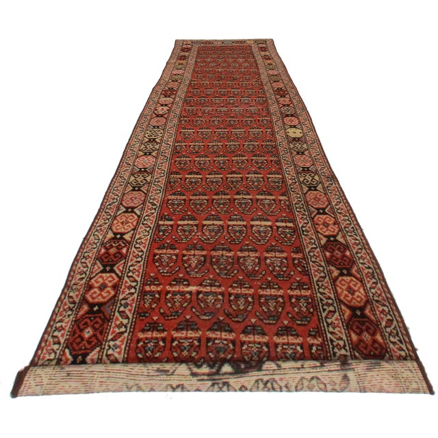 Here is an antique Persian Hamedan runner. Made of hand-knotted wool. Lovely geometric, repeating design.