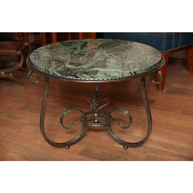 """Paul Kiss (1885-1962). Art Deco gueridon, circa 1930 stamped """"P. Kiss France."""" Wrought iron with Portoro marble top...."""