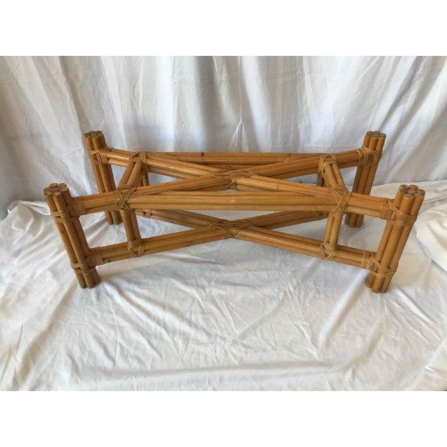 Gorgeous X -design center rattan coffee table with glass top. Each leg is made up of (7) pieces of rattan. It is an...