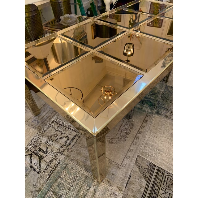 This is a brass dining table made by the iconic Mastercraft Company. This table has a parsons style with just the right...