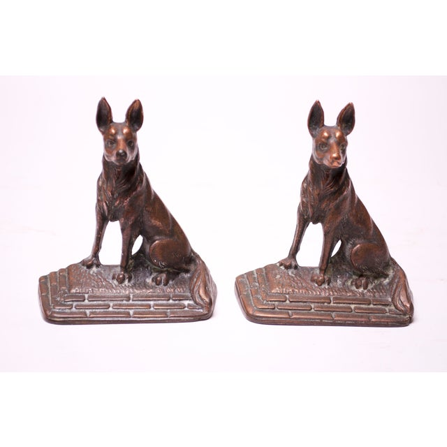 Circa 1929 cast iron German Shepherd Bookends with a copper finish. Art Colony Industries and Hubley both made these...