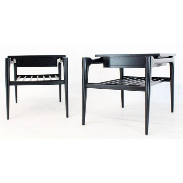 Pair of Mid-Century Modern black lacquer step end tables. Sculptured tapered solid mahogany legs. In Italian style of Ico...