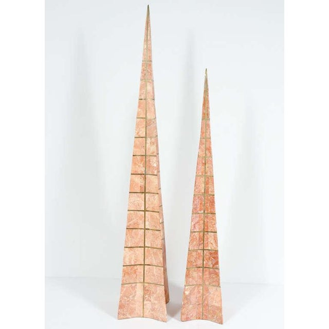 A pair of obelisks each in an elongated pyramid form with concave sides, bronze inlay in a lattice form with pointed...