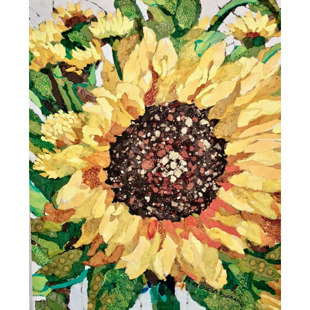 This is a sunflower field study collage on a wood board. It's made with hand-painted papers done in acrylic paint which...