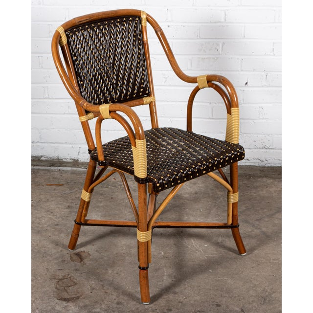 Set of 8 Palecek rattan garden style dining room chairs