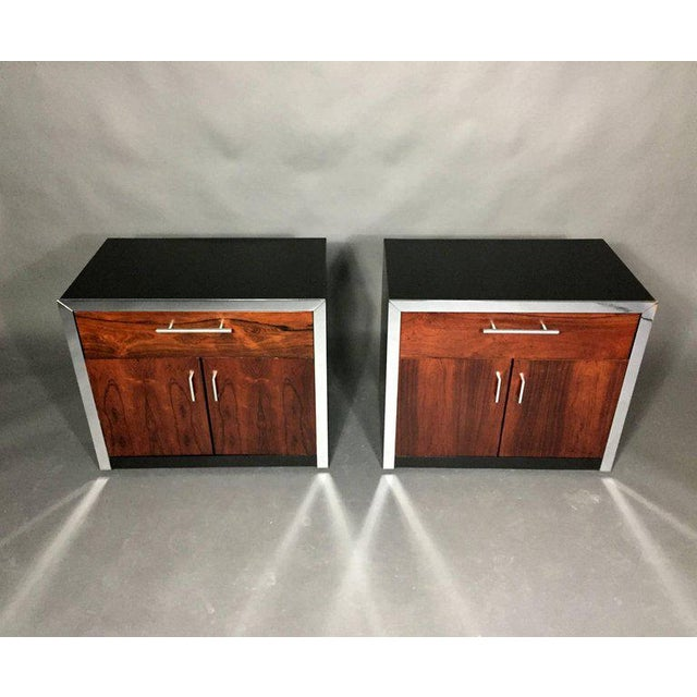 The combination of rosewood fronts and black formica top or sides is striking - this pair of nightstands adds a perfect...