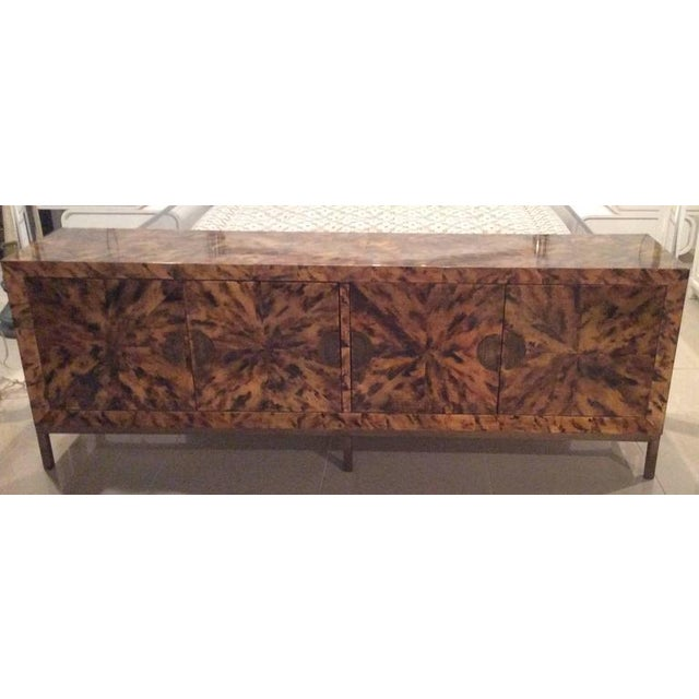 Such an amazing, one of a kind credenza, buffet, dresser. Four doors open to cabinet (inside shown) Unique brass hardware...