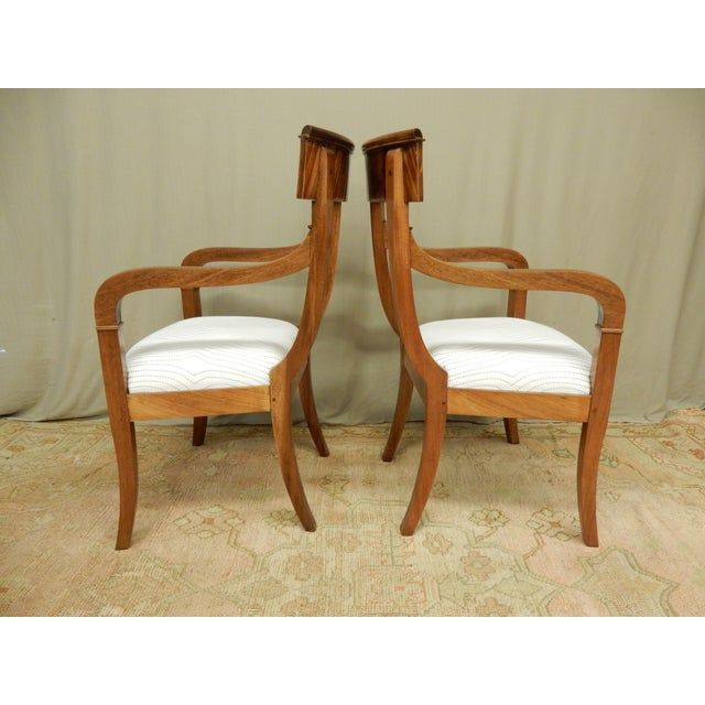 Pair of French Neo-Classical Empire armchairs. Carefully restored to retain original beauty and patina, structurally sound.