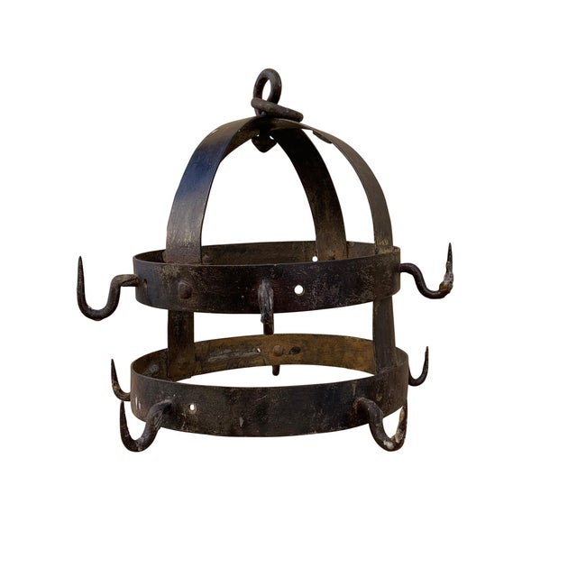 A beautiful 18th century French handwrought iron game rack with two outer rings with ten hooks. Game racks were used to...