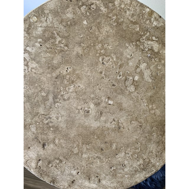 Striking, heavy plaster occasional table that adds traditional form and organic texture to any home design. This table...