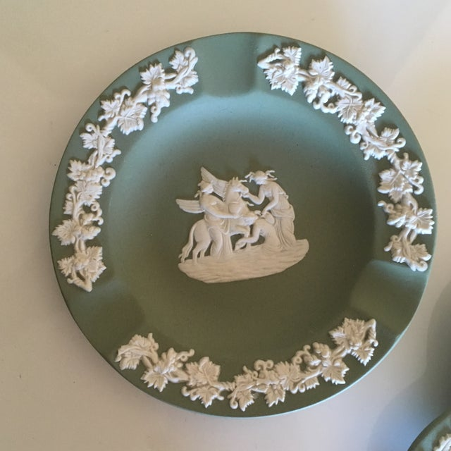 Beautiful decorative pair of Wedgwood Jasperware Ashtrays in a soft sage green. Maker's Mark on bottom of both ashtrays....
